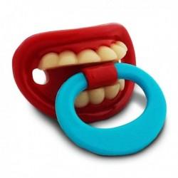 Sucette en forme de bouche avec dents et anneau